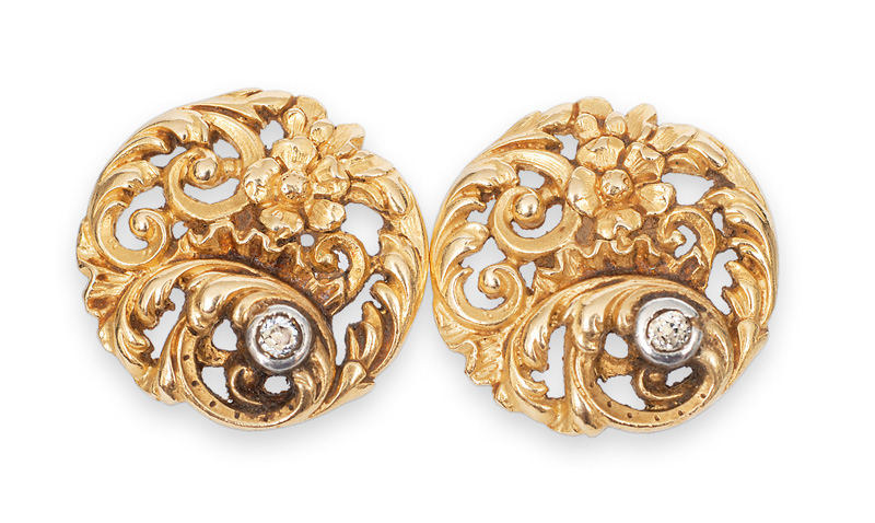 A pair of Art-Nouveau gold earstuds with diamonds