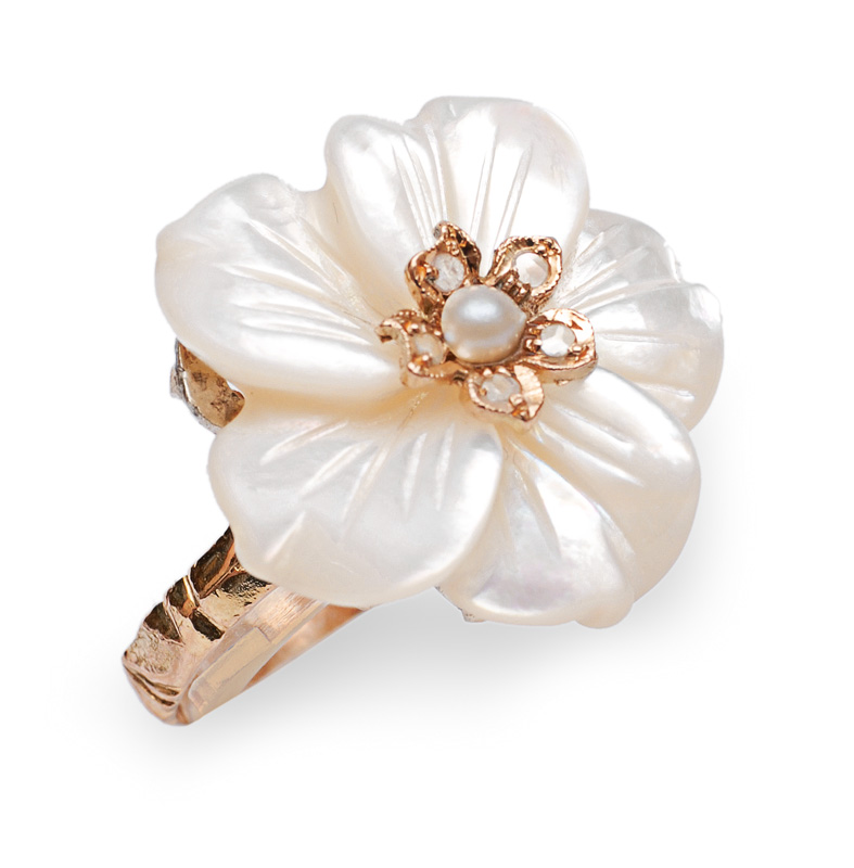 A mother of pearl ring in flower shape