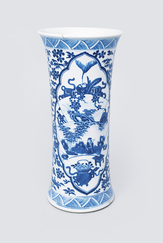 A vase with blue decoration