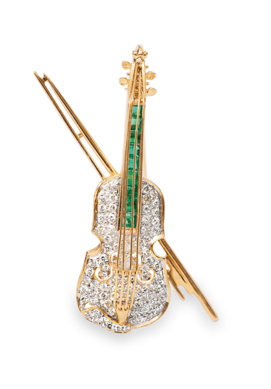 "A fine brooch with diamonds and emeralds ""Violin"" by Gübelin"