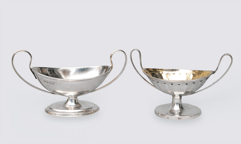 A pair of classical, small bowls with handles