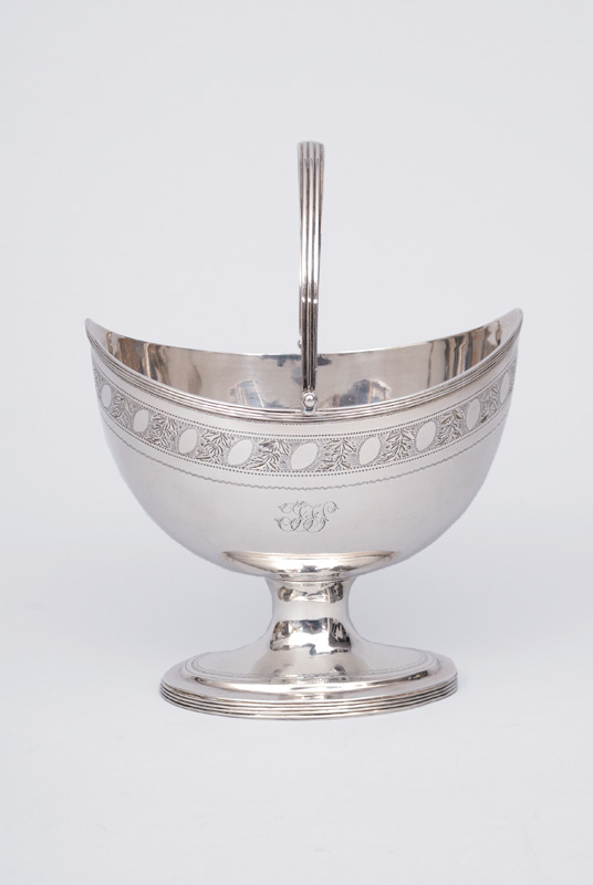 A Georgian bowl with handle and fine engraved decor