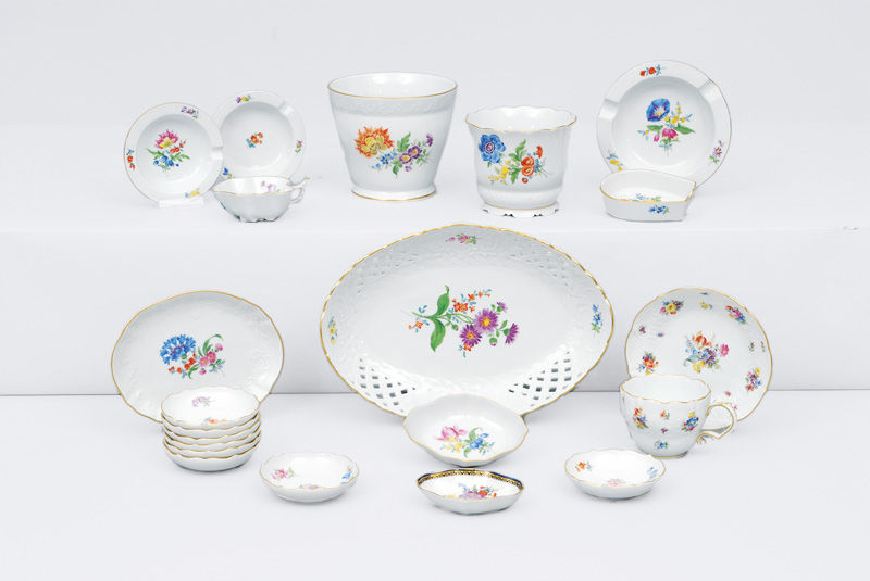 A convolute of bowls and vases with flower painting and gilded rim