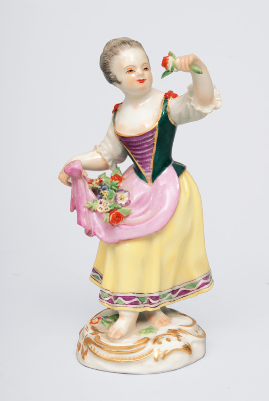 "A figurine Gardener""s child with flower pinafore"""