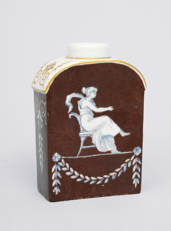 A brown grounded Empire tea caddy with gray painting
