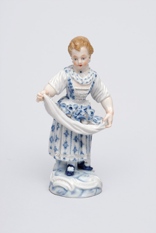"A figurine ""Gardener""s child with flower pinafore"""