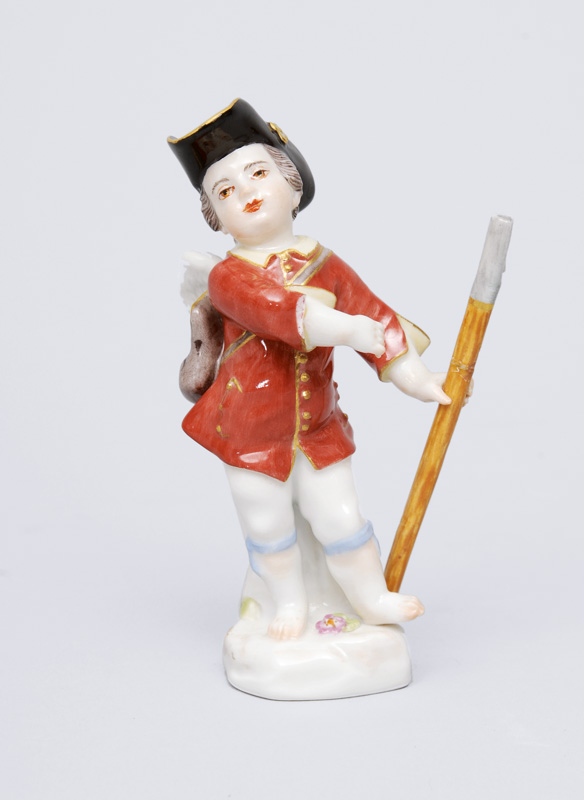 "A figurine ""small disguised amoretto with stick"""