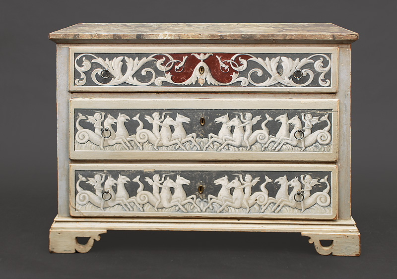 A coloured Louis-Seize chest of drawers with decoration of hippocampus