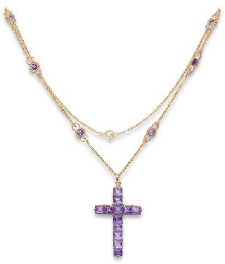 A Georgian amethyst pendant in the shape of a cross with a necklace