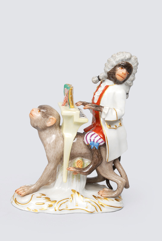 "A figurine ""organ player"" (chief conductor riding) of ""music playing monkeys"""
