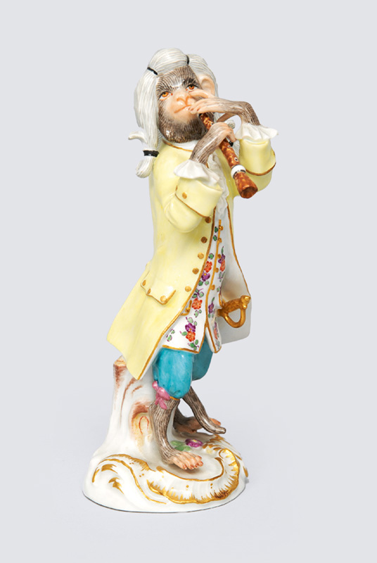 "A figurine ""clarinet player"" of serial ""music playing monkeys"""