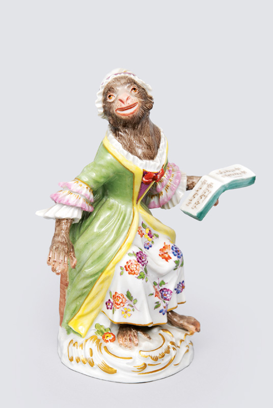"A figurien ""female singer"" of serial ""music playing monkeys"""