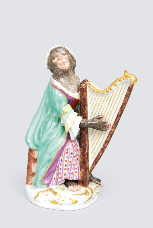 "A figurine ""female harp player"" of serial ""music playing monkeys"""