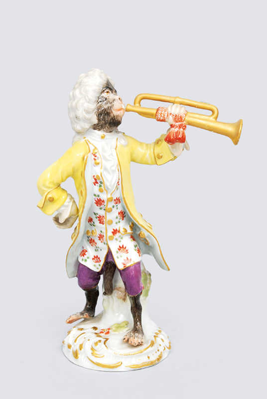 "A figurine ""trumpet eplayer"" of serial ""music playing monkeys"""