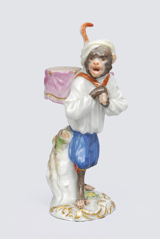"A figurine ""kettle drum carrier"" of serial ""music playing monkeys"""