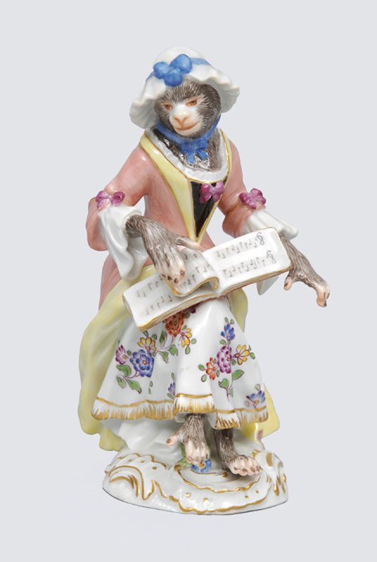 "A figurine ""female singer"" of serial ""music playing monkeys"""