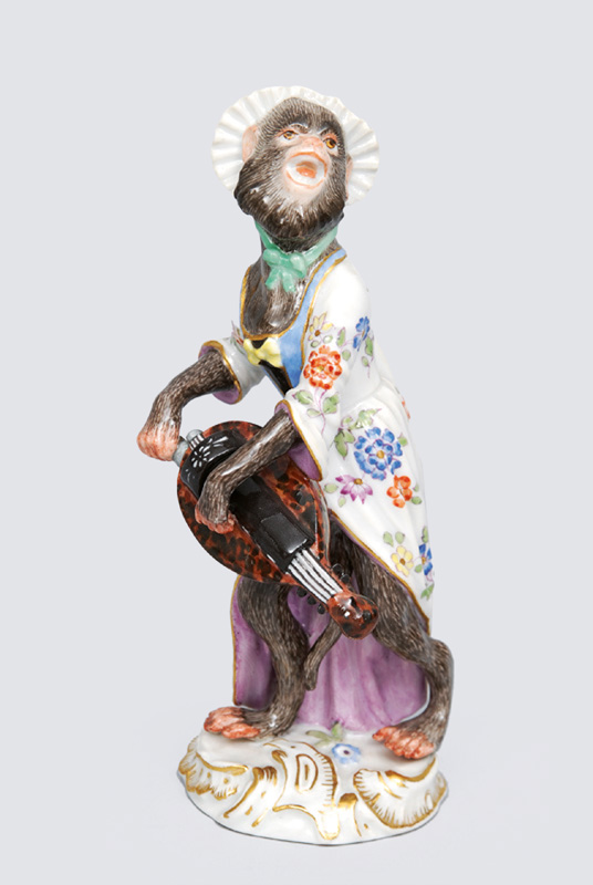 "A figurine ""female hurdy-gurdy player"" of serial ""music playing monkeys"""