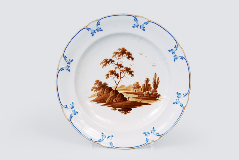 A big plate with river landscape in sepia painting