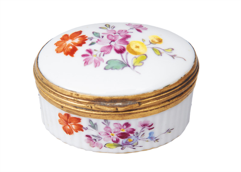 An oval snuff box with flower painting