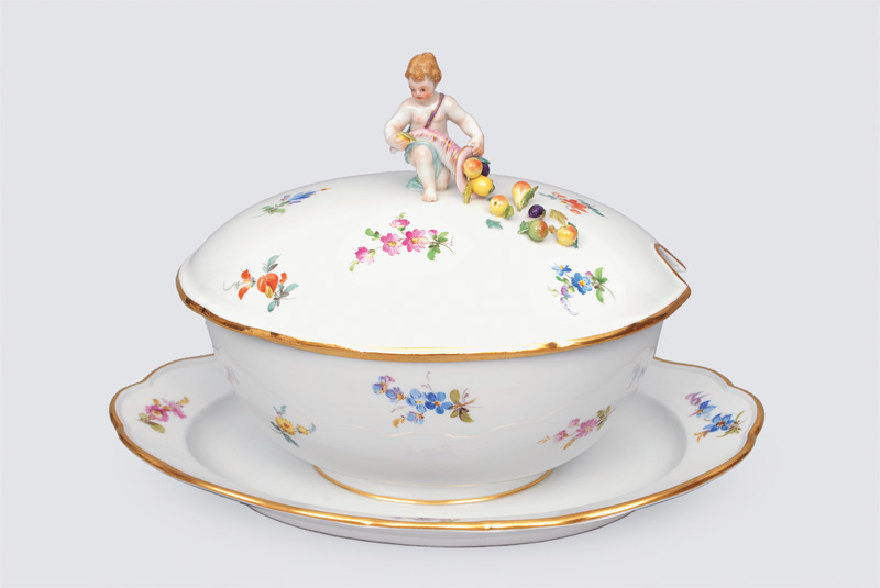 "A big sauce boat ""strewn flowers"" with putto knob"