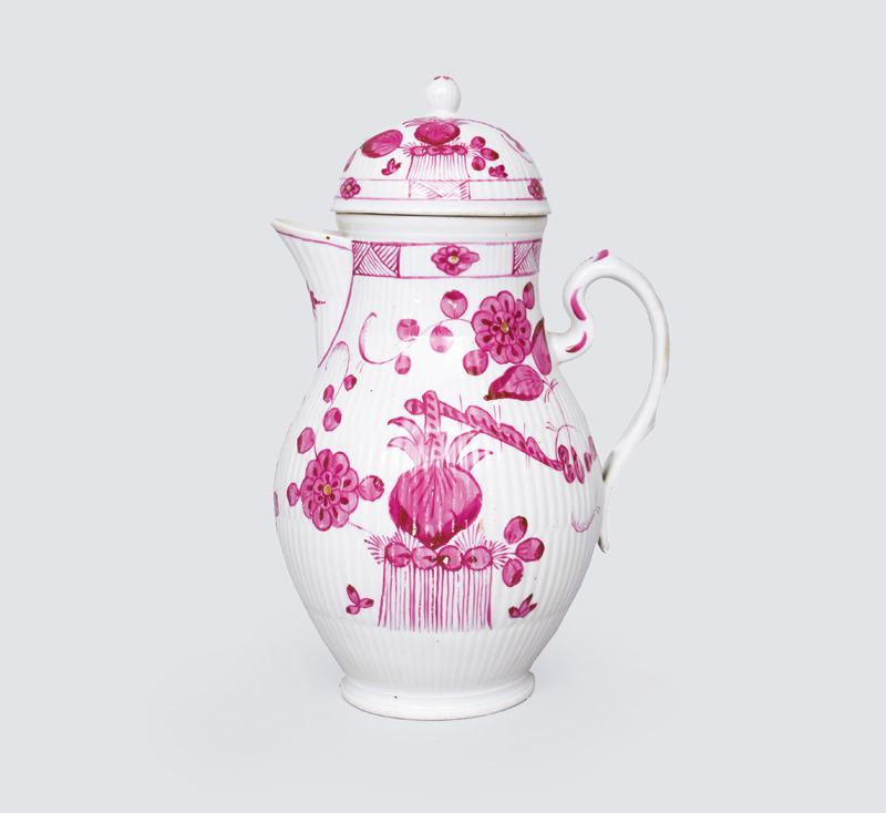 A big coffee pot with crimson painting