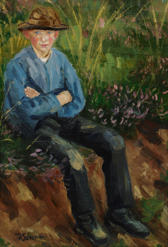 Boy seated on a grassy Bank
