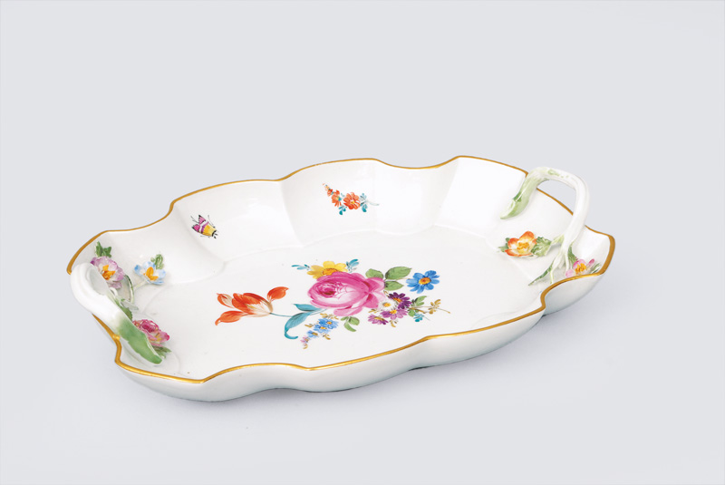 A curved bowl with painted flowers and insects