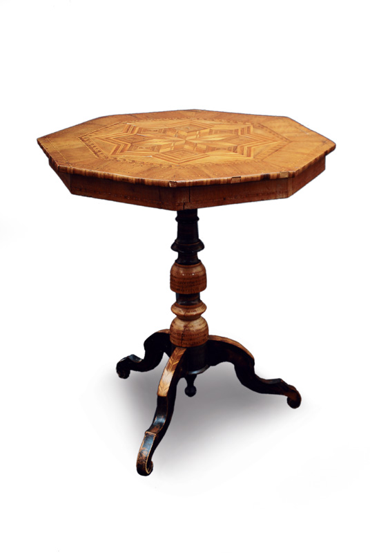 A small tea table with inlays of stars