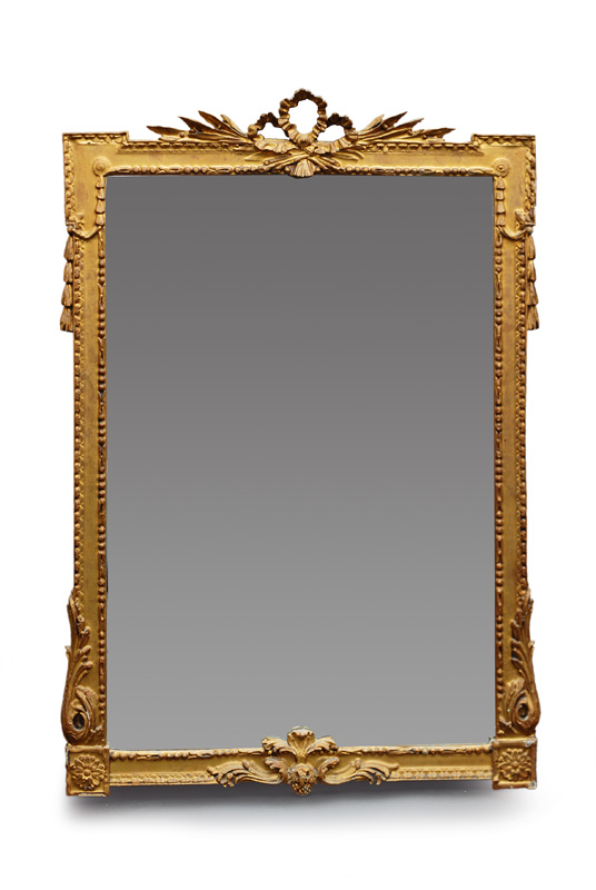 A large mirror with fine Empire ornament