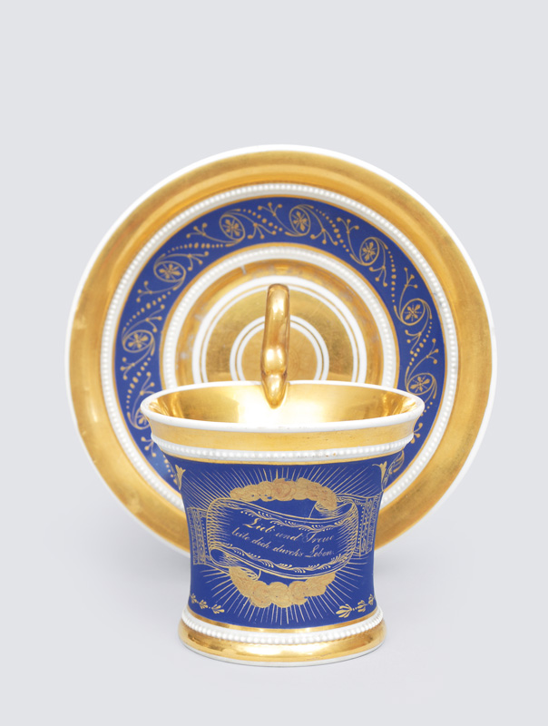 An Empire cup with lapislazuli ground and gold painting