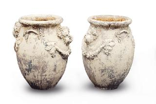 A pair of large cachepots with ornaments of putti