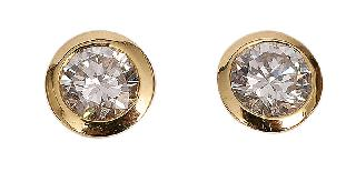 A pair of classic solitaire earrings