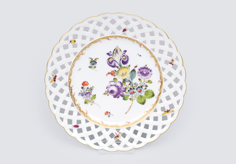 An openwork plate with flowers and insects