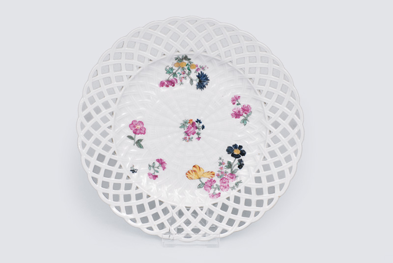 An openwork plate with stylised flowers