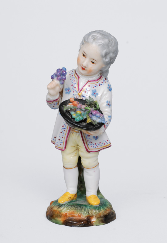 "A small figurine ""Boy with fruits"""