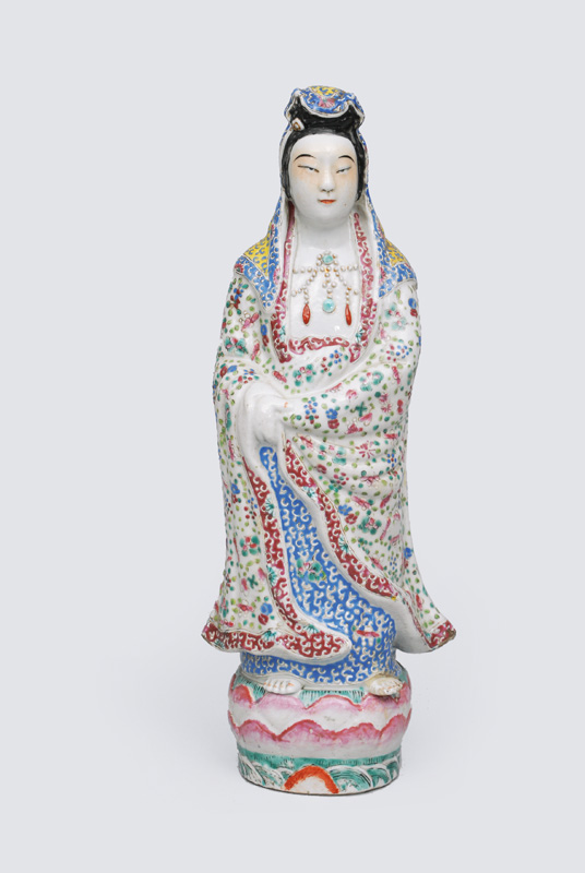 "A figurine ""Standing Guanyin"" on Lotus thron"