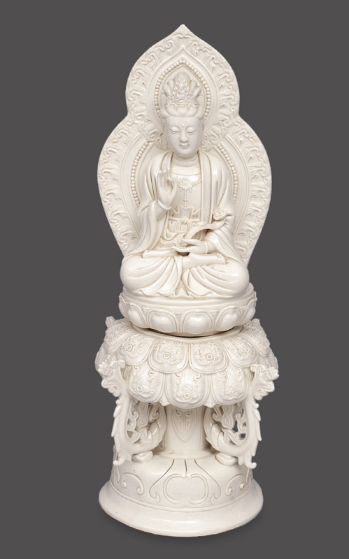 "A blance-de-Chine figurine ""Guanyin"" on rich decorated lotus throne"