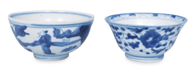 A pair of small bowls with blue painting