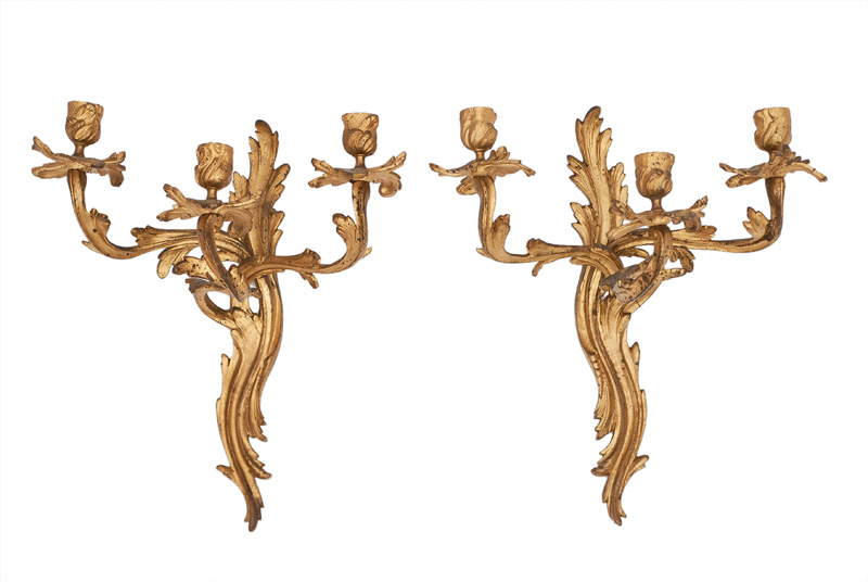 A pair of sconces in the style of Rococo