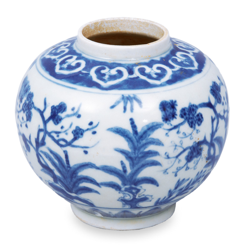 A small vase with floral painting in blue