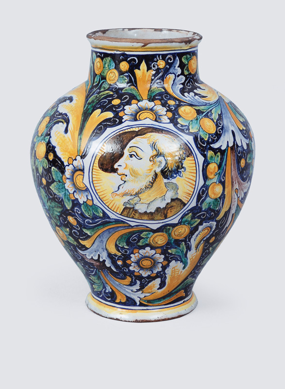 A vase with portrait locket