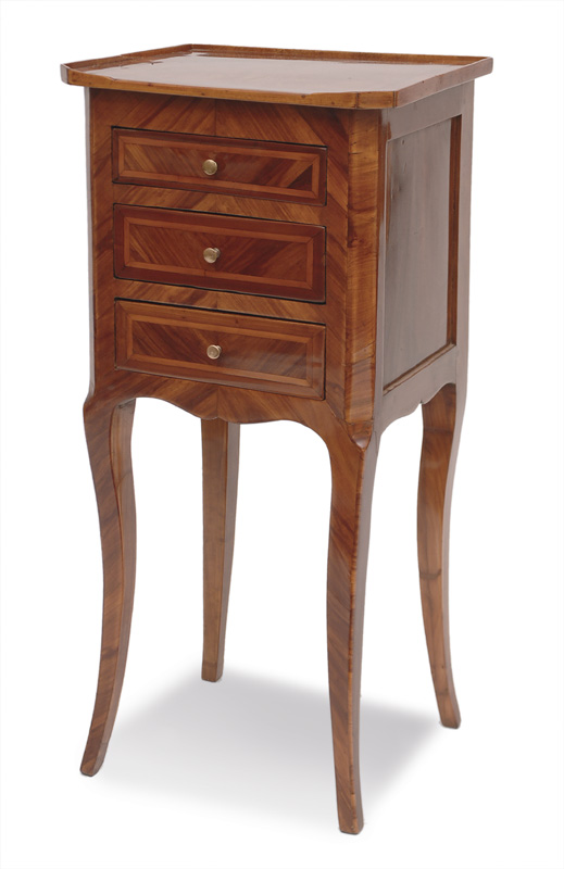 A small chest of drawers in the style of Louis Qunize