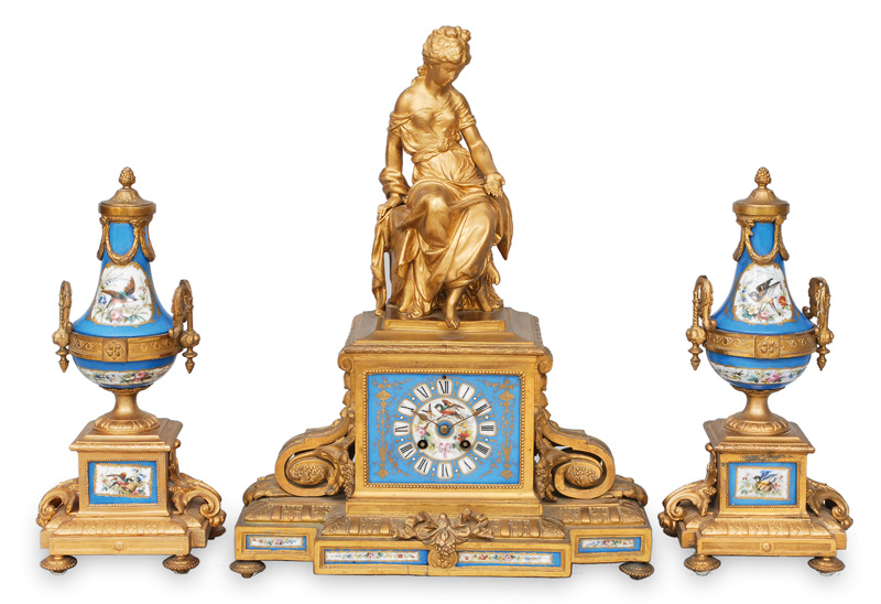 A three-piece-set for the fireplace with a pendulum clock