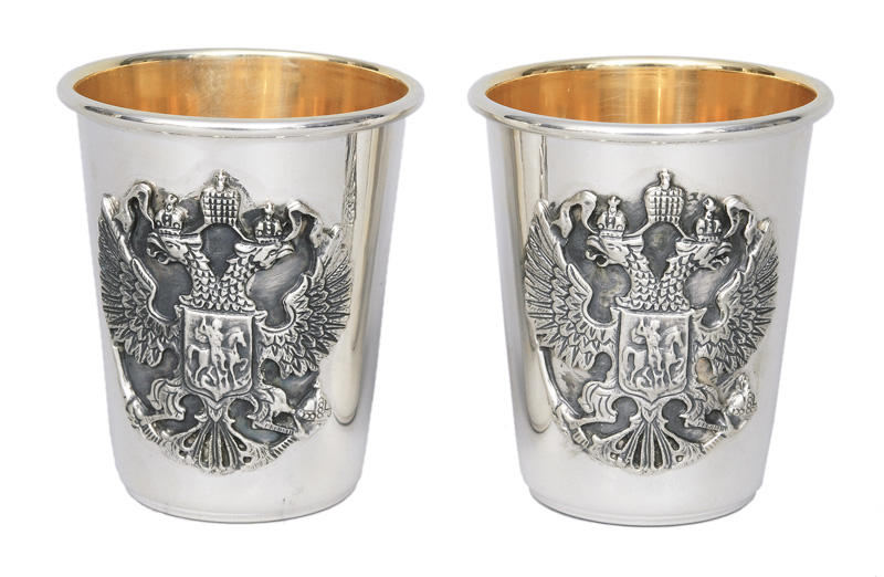 A pair of beaker with applied russian double eagle