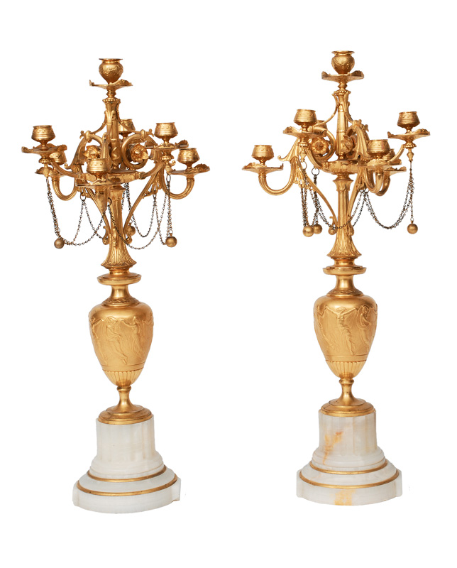 A pair of Napoleon-III candle holders with frieze ornaments