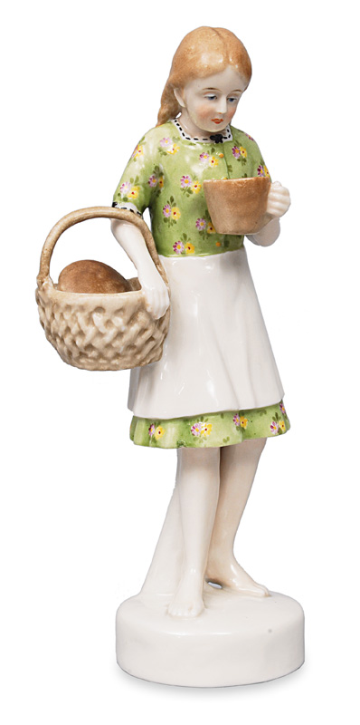 "An Art Nouveau figurine ""Girl with milk cup and bread basket"""