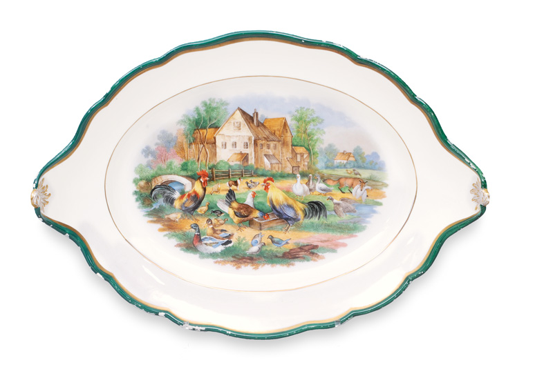 A large oval platter with poultry