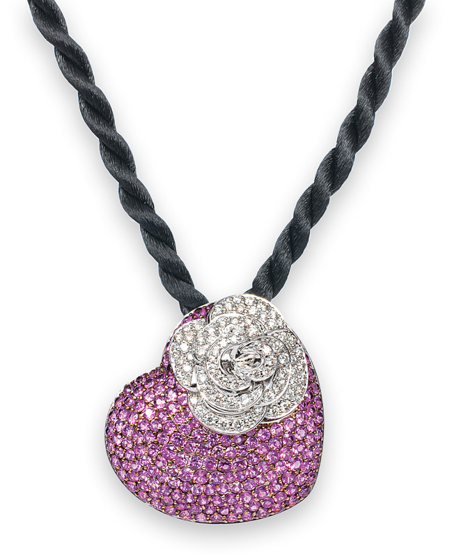 A heartshaped pendant with pink sapphires and diamonds