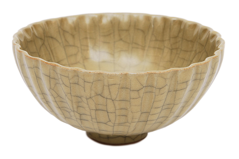 An olive green celadon bowl