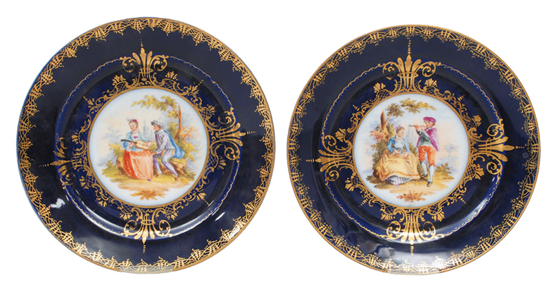 A pair of cobalt blue grounded plates with Boucher szenes in styl of Vienna